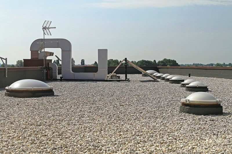 Roofing Experts - Gravel Flat Roof